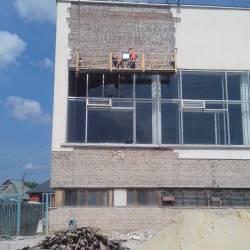 Демонтаж фасадной облицовки здания